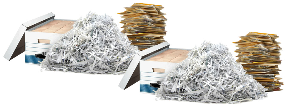 Two large boxes of paper business files sit next to two stacks of paper business files which sit next to two piles of shredded paper.