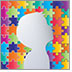 A beautiful puzzle pattern of rainbow colored pieces shows the silhouette of a small child in the foreground.