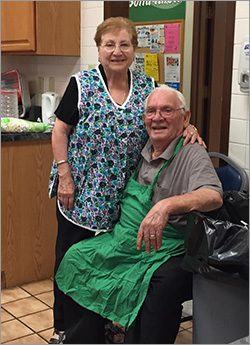 Photo of Mama and Papa Catena taking a break from their cooking duties at the Family Fun Carnival Sponsored by the Community Partnership on Aging and the Brush High School PTSA, August 2017. Mama, Papa, daughter Fran and her husband Steve cooked a beautiful Pasta meal for all who attended.