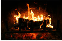 Photo of a wood burning fireplace.