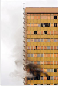 Photo of a high rise on fire.